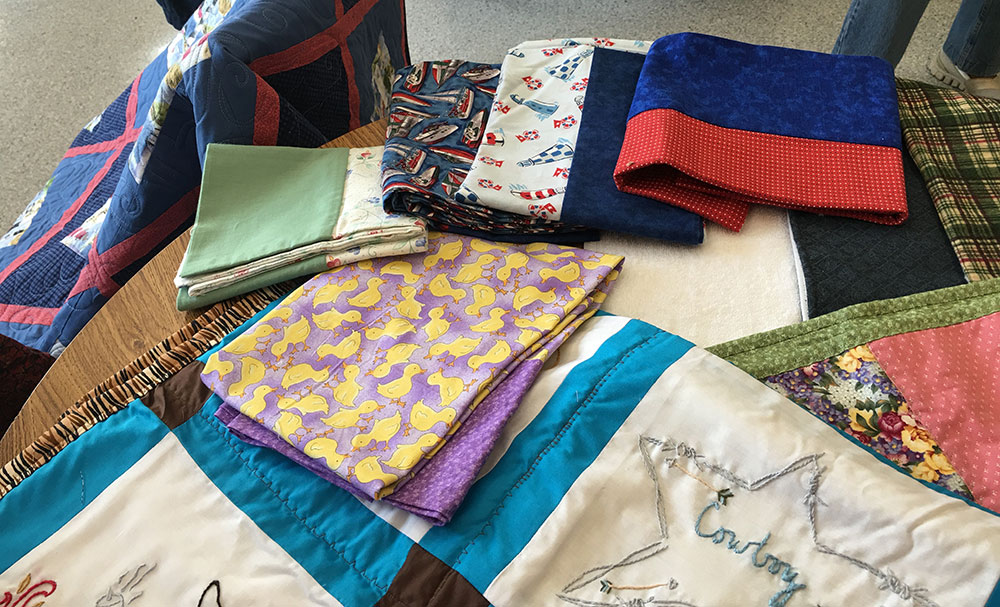 An assortment of pillowcases and bags for foster children